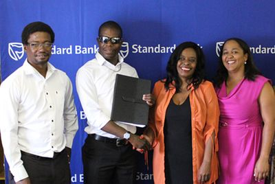 Namibian Paralympian, Ananias Shikongo with the Standard Bank Namibia team.
