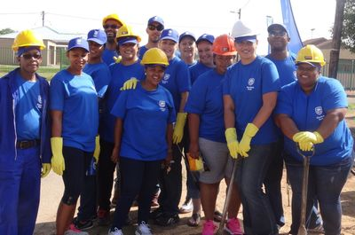 Our excited Bloemfontein CSI team on site to build houses