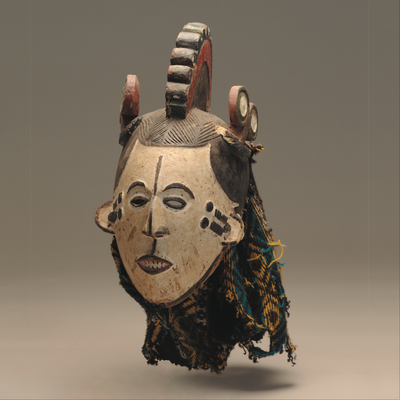 Igbo. Nigeria. Mmwo (maiden spirit mask). Undated. Wood, pigment, wool, nails. Standard Bank African Art Collection (Wits Art Museum)