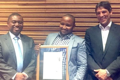 Siphe Macanda of the Daily Dispatch (centre) is the winner of the 2016 Standard Bank Sikuvile Award for Newspaper Journalist of the Year. With him at the awards presentation are Standard Bank Group Chief Executive Sim Tshabalala (left) and Media24 General Manager Ishmet Davidson.