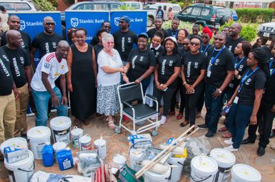 Stanbic Bank Zambia's Personal and Business Banking team share their day with the Bauleni Special Needs Project and make a donation of K60,000 of much-needed items for its school.