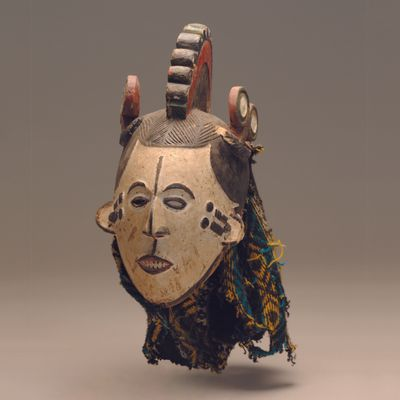 Igbo. Nigeria. Mmwo (maiden spirit). Mask. Undated. Wood, pigment, wool, nails. Standard Bank African Art Collection (Wits Art Museum)