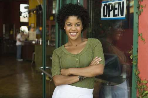 african_business_woman_standing_in_front_of_shop_smiling_78375490_Internet_RGB (1).jpg